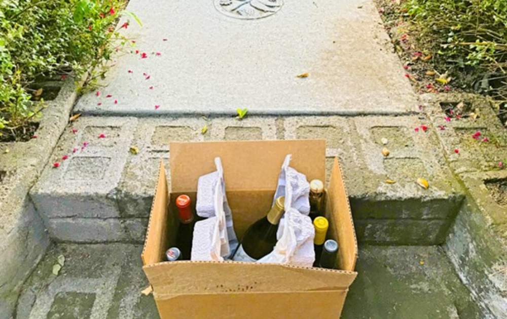 Box of wine on front porch